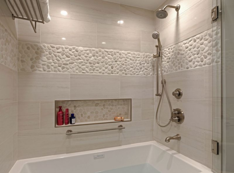 white shower and tub with tile shelf