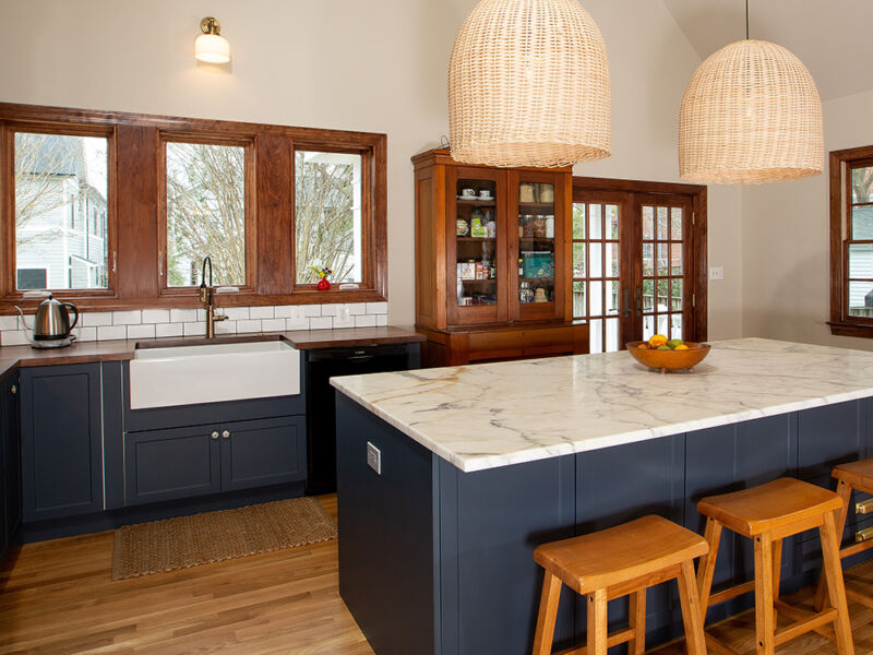 transitional style kitchen with blue cabinets