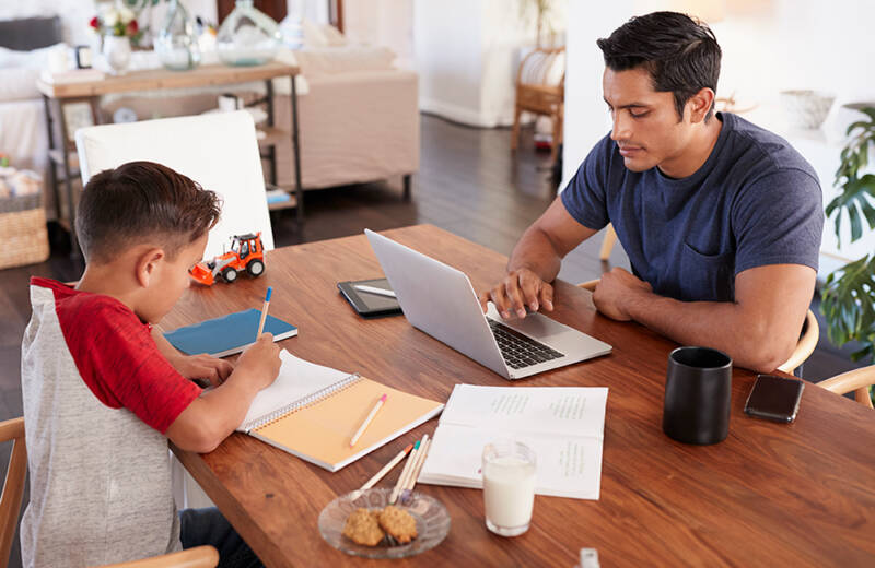 father and son working at kitchen table